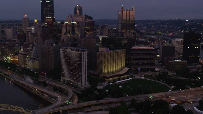 4K stock footage aerial video of Downtown Pittsburgh skyline from Allegheny River, Pennsylvania, twilight Aerial Stock Footage | AX108_113