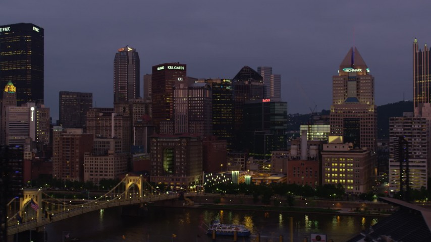 4K stock footage aerial video of Downtown Pittsburgh skyscrapers seen from Allegheny River, Pennsylvania, twilight Aerial Stock Footage | AX108_115
