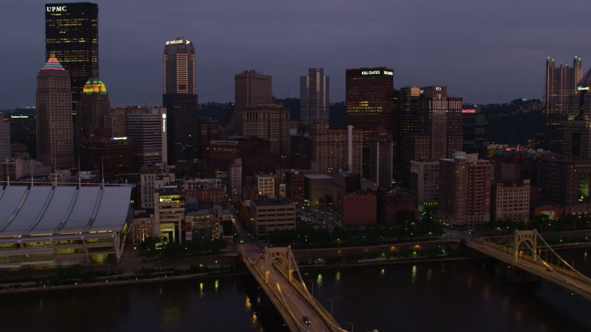 4K stock footage aerial video of Downtown Pittsburgh skyscrapers from Allegheny River, Pennsylvania, twilight Aerial Stock Footage | AX108_117