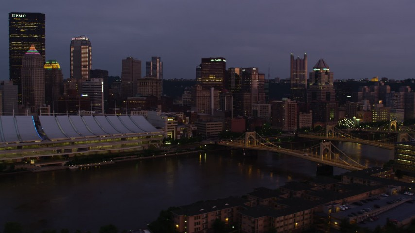 4K stock footage aerial video flying by bridges and Downtown Pittsburgh skyscrapers, Pennsylvania, twilight Aerial Stock Footage | AX108_118