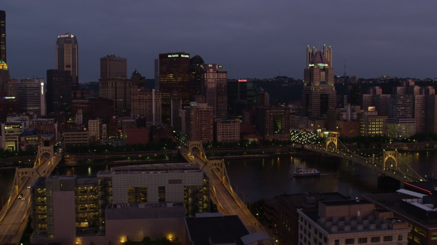4K stock footage aerial video flying by bridges and Downtown Pittsburgh skyscrapers, Pennsylvania, twilight Aerial Stock Footage   AX108_119