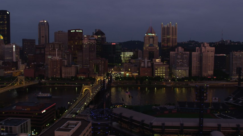 4K stock footage aerial video flying by Downtown Pittsburgh skyscrapers seen from PNC Park, Pennsylvania, twilight Aerial Stock Footage | AX108_120