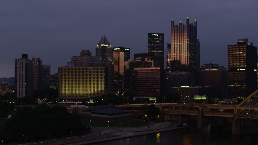 4K stock footage aerial video of Downtown Pittsburgh skyscrapers from Fort Pitt Bridge, Pennsylvania, twilight Aerial Stock Footage | AX108_124
