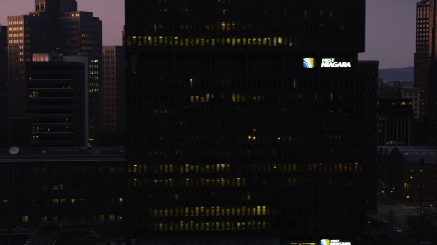 4K stock footage aerial video of skyscrapers, office buildings and city streets, Downtown Pittsburgh, Pennsylvania, twilight Aerial Stock Footage | AX108_125