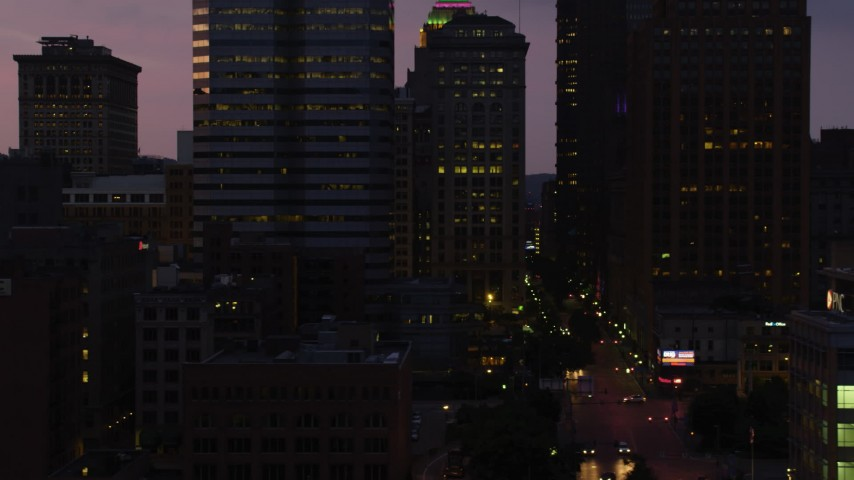 4K stock footage aerial video flying by skyscrapers and city streets, Downtown Pittsburgh, Pennsylvania, twilight Aerial Stock Footage | AX108_130