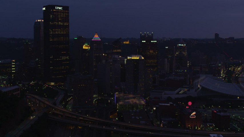 4K stock footage aerial video of Downtown Pittsburgh skyscrapers, Pennsylvania, twilight Aerial Stock Footage | AX108_138