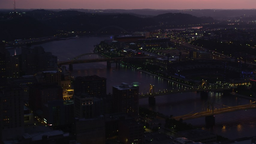 4K stock footage aerial video of PNC Park, Heinz Field and Allegheny River, Pittsburgh, Pennsylvania, twilight Aerial Stock Footage | AX108_142