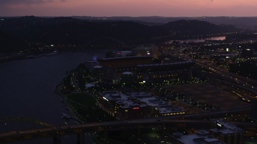 4K stock footage aerial video approaching Heinz Field, Pittsburgh, Pennsylvania, twilight Aerial Stock Footage | AX108_144