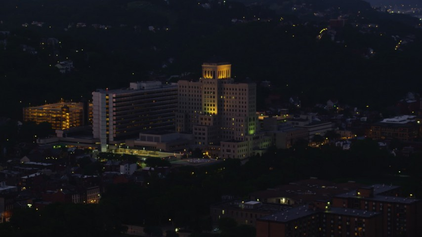 4K stock footage aerial video approaching Allegheny General Hospital, Pittsburgh, Pennsylvania, night Aerial Stock Footage | AX108_146