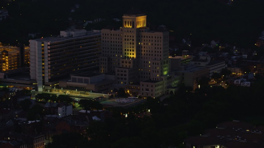 4K stock footage aerial video approaching Allegheny General Hospital, Pittsburgh, Pennsylvania, night Aerial Stock Footage | AX108_147