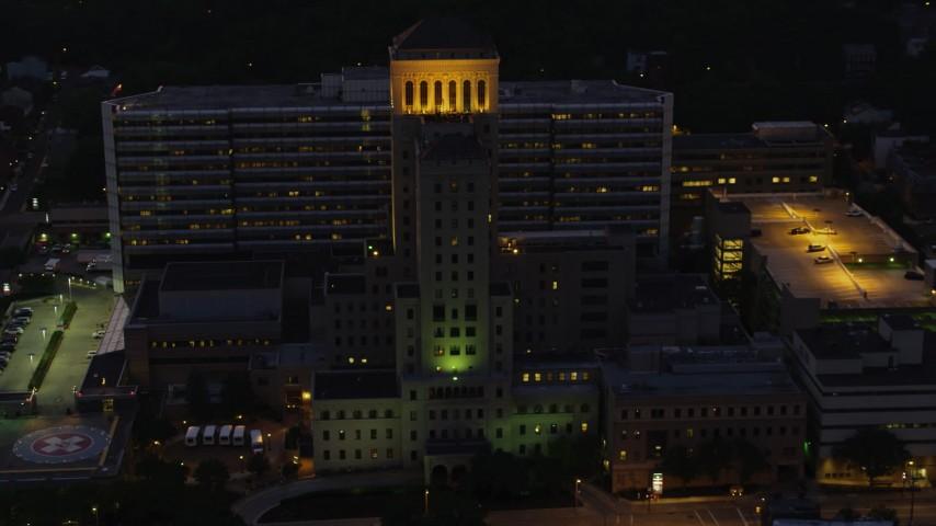4K stock footage aerial video orbiting Allegheny General Hospital, Pittsburgh, Pennsylvania, night Aerial Stock Footage | AX108_149