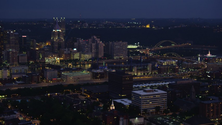 4K stock footage aerial video of Downtown Pittsburgh seen from north of the city, Pennsylvania, night Aerial Stock Footage   AX108_150