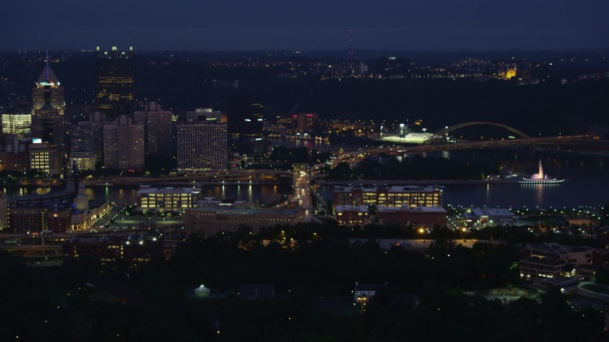 4K stock footage aerial video passing Downtown Pittsburgh skyscrapers and Point State Park, Pennsylvania, night Aerial Stock Footage | AX108_153