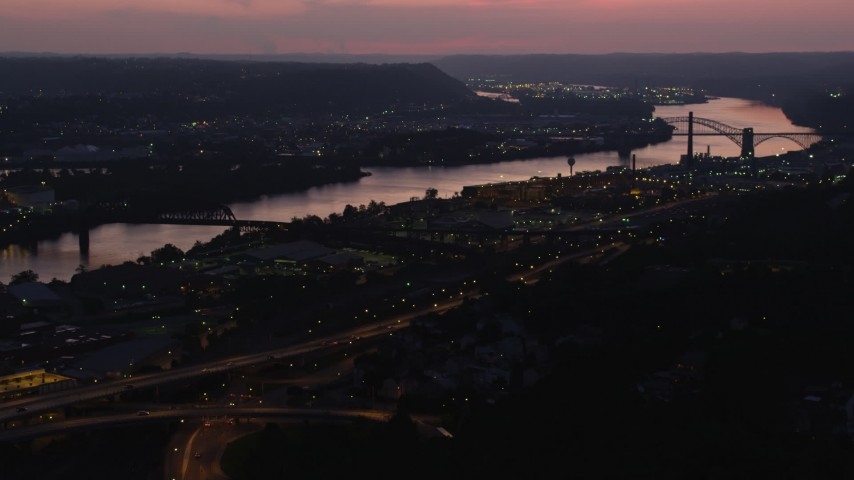 4K stock footage aerial video approaching Western State Penitentiary along the river, Pittsburgh, Pennsylvania, twilight Aerial Stock Footage | AX108_154