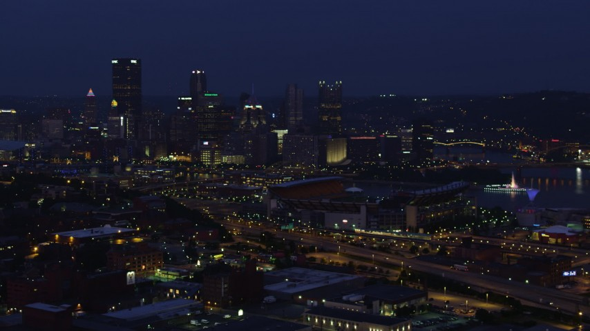 4K stock footage aerial video approaching Downtown Pittsburgh and Heinz Field, Pennsylvania, night Aerial Stock Footage | AX108_157