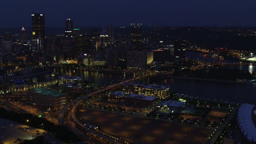 4K stock footage aerial video of Downtown Pittsburgh skyscrapers seen from north of the city, Pennsylvania, night Aerial Stock Footage | AX108_161
