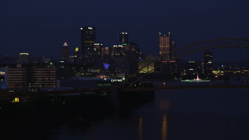 4K stock footage aerial video of Downtown Pittsburgh skyscrapers from West End Bridge, Pennsylvania, night Aerial Stock Footage | AX108_164
