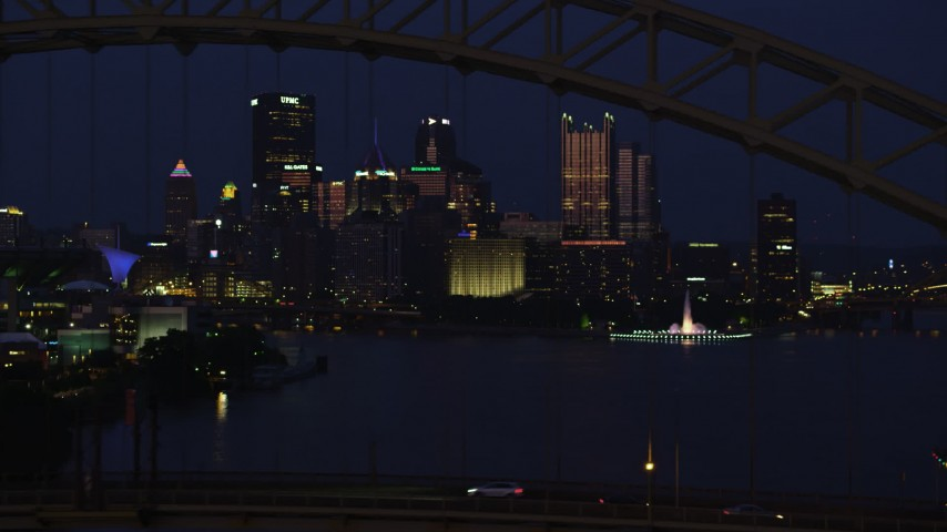 4K stock footage aerial video of Downtown Pittsburgh skyscrapers and Point State Park; night Aerial Stock Footage | AX108_165