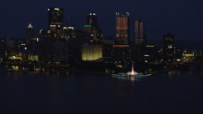 4K stock footage aerial video of Downtown Pittsburgh skyscrapers and Point State Park, Pennsylvania, night Aerial Stock Footage | AX108_166