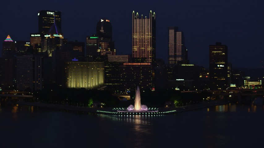 4K stock footage aerial video approaching Point State Park fountain and Downtown Pittsburgh, night Aerial Stock Footage | AX108_167