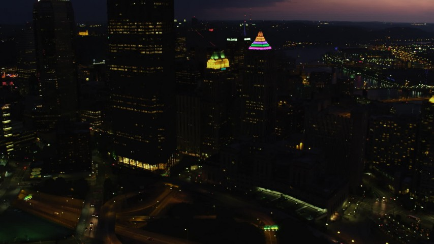 4K stock footage aerial video of Gulf Tower and U.S. Steel Tower, Pittsburgh, Pennsylvania, twilight Aerial Stock Footage   AX108_177