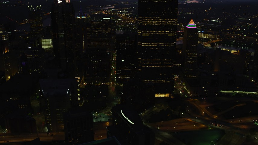 4K stock footage aerial video of BNY Mellon Center, U.S. Steel Tower over the city, Pittsburgh, night Aerial Stock Footage | AX108_179