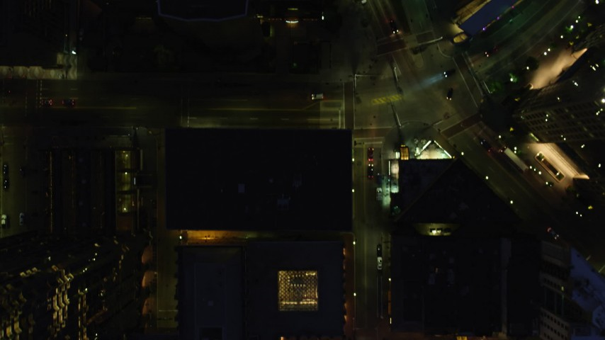 4K stock footage aerial video of a bird's eye of city streets and buildings revealing a hotel, Downtown Pittsburgh, Pennsylvania, night Aerial Stock Footage   AX108_183
