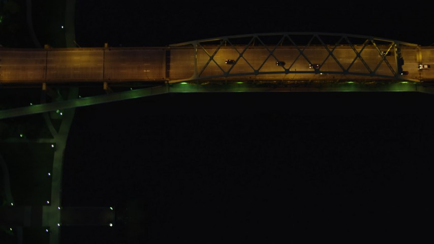4K stock footage aerial video of a bird's eye orbiting Fort Duquesne Bridge, Downtown Pittsburgh, night Aerial Stock Footage | AX108_185