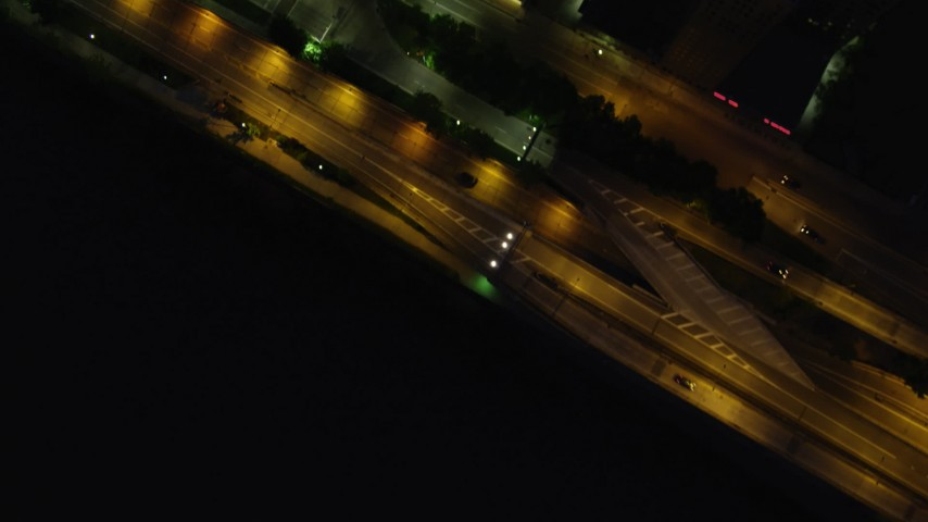 4K stock footage aerial video of a bird's eye of city streets, Downtown Pittsburgh, Pennsylvania, night Aerial Stock Footage | AX108_186