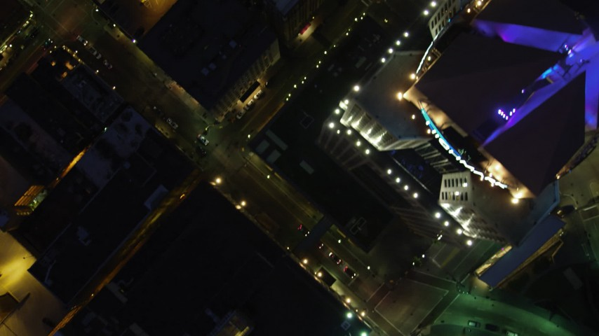 4K stock footage aerial video of a bird's eye of city streets and buildings, Downtown Pittsburgh, Pennsylvania, night Aerial Stock Footage | AX108_187
