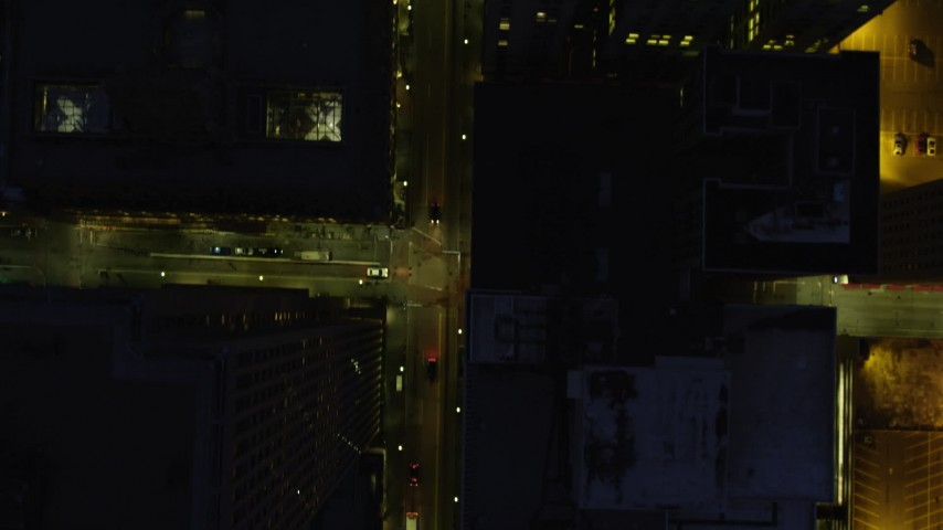 4K stock footage aerial video of a bird's eye following city streets, Downtown Pittsburgh, Pennsylvania, night Aerial Stock Footage | AX108_189