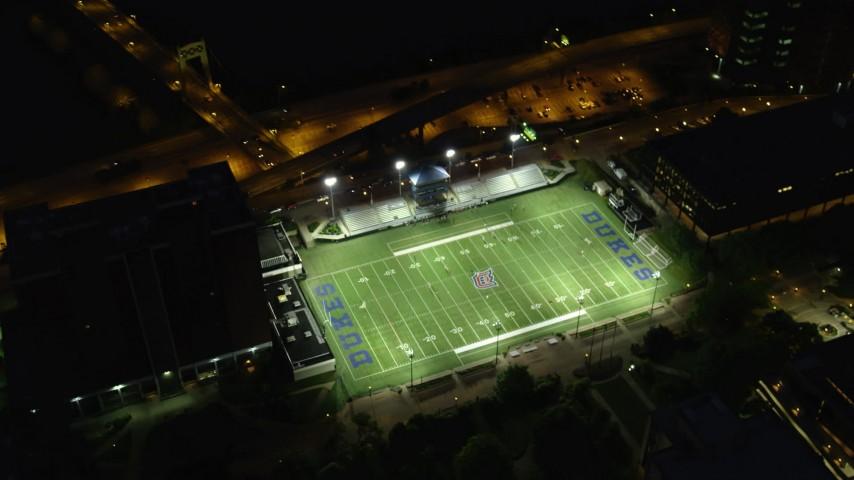 4K stock footage aerial video of a bird's eye orbiting Arthur J. Rooney Athletic Field, Pittsburgh, night Aerial Stock Footage | AX108_191