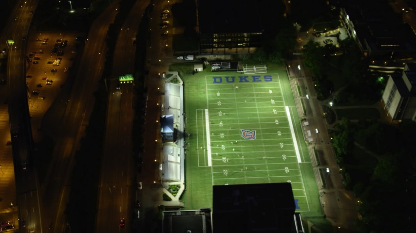 4K stock footage aerial video orbiting Arthur J. Rooney Athletic Field and tilt up to reveal the city, Pittsburgh, night Aerial Stock Footage | AX108_192