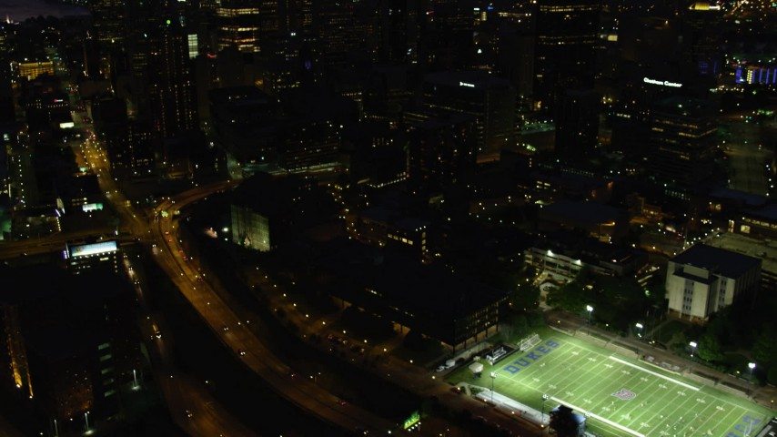 4K stock footage aerial video tilting up to skyscrapers from Monongahela River, Downtown Pittsburgh, Pennsylvania, night Aerial Stock Footage | AX108_193