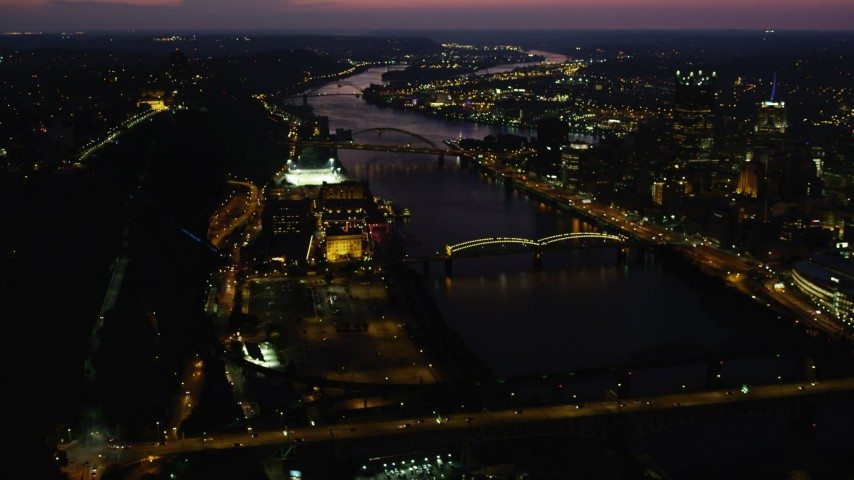 4K stock footage aerial video of bridges spanning the Monongahela River, Downtown Pittsburgh, Pennsylvania, night Aerial Stock Footage | AX108_194