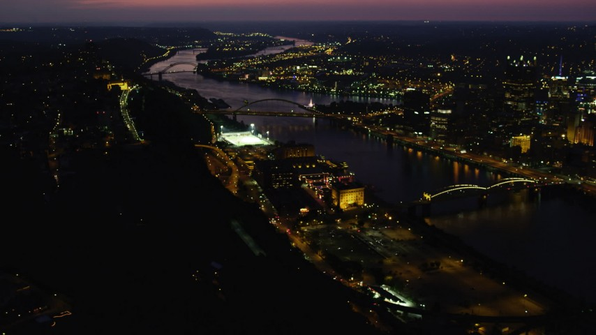 4K stock footage aerial video of bridges spanning the Monongahela River, Downtown Pittsburgh, Pennsylvania, night Aerial Stock Footage | AX108_195