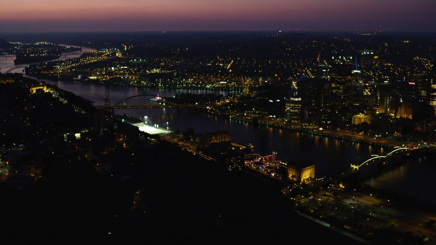 4K stock footage aerial video of bridges spanning the Monongahela River, Downtown Pittsburgh, Pennsylvania Aerial Stock Footage | AX108_196