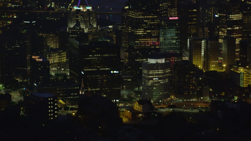 4K stock footage aerial video flying by city buildings, Downtown Pittsburgh, Pennsylvania, night Aerial Stock Footage | AX108_199