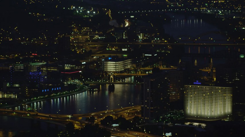 4K stock footage aerial video of small bridges spanning the Allegheny River, Downtown Pittsburgh, Pennsylvania, night Aerial Stock Footage | AX108_200