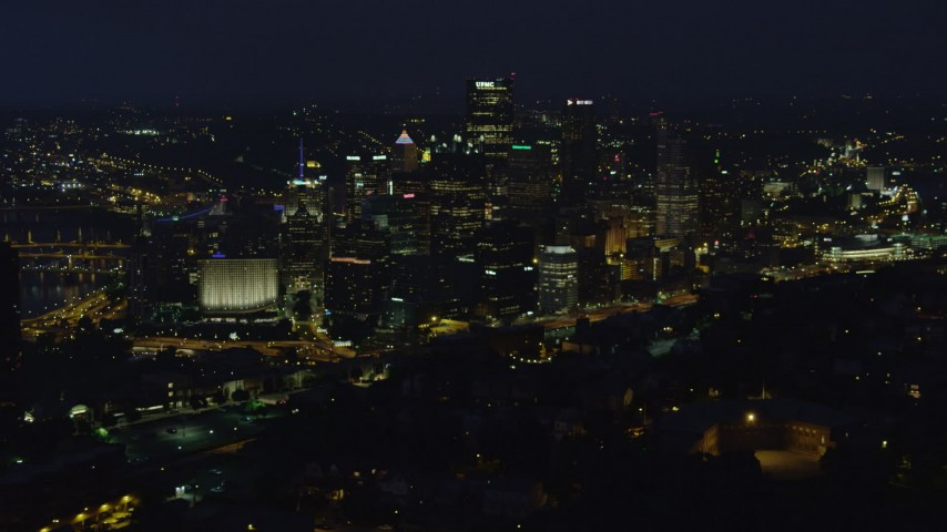 4K stock footage aerial video of skyscrapers seen from Monongahela River, Downtown Pittsburgh, Pennsylvania, night Aerial Stock Footage | AX108_202