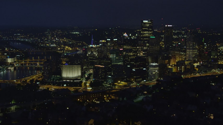 4K stock footage aerial video of city skyscrapers and buildings, Downtown Pittsburgh, Pennsylvania, night Aerial Stock Footage | AX108_203