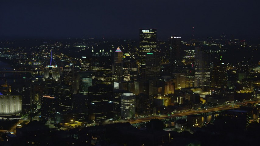 4K stock footage aerial video of Downtown Pittsburgh city buildings and skyscrapers, Pennsylvania, night Aerial Stock Footage   AX108_204