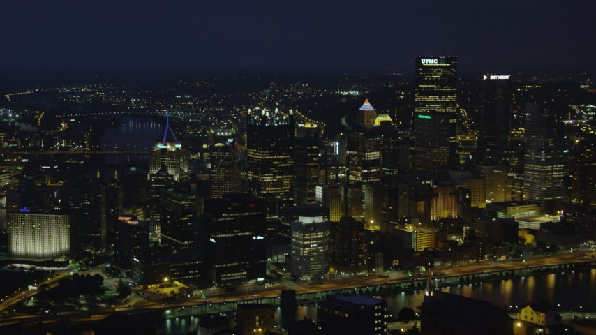 4K stock footage aerial video of Downtown Pittsburgh skyscrapers from Monongahela River, Pennsylvania, night Aerial Stock Footage | AX108_205