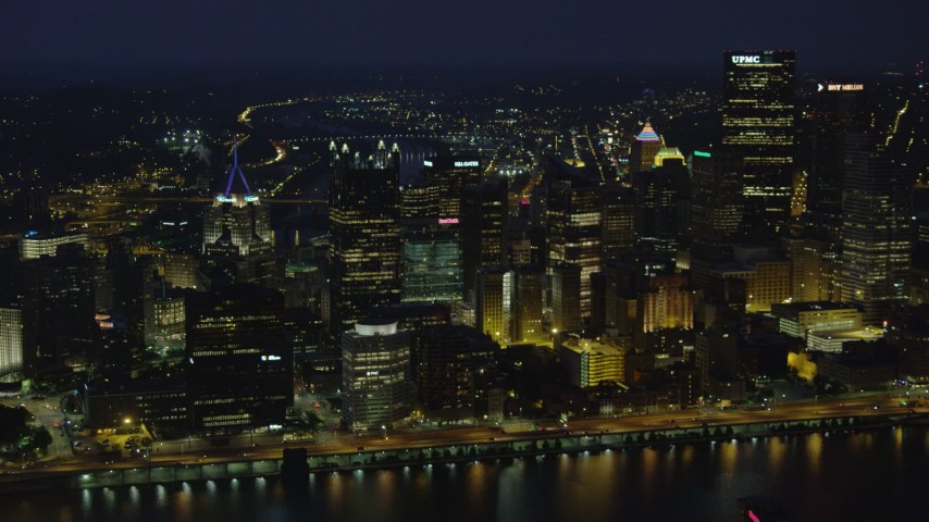 4K stock footage aerial video of Downtown Pittsburgh skyscrapers from Monongahela River, Pennsylvania, night Aerial Stock Footage | AX108_206