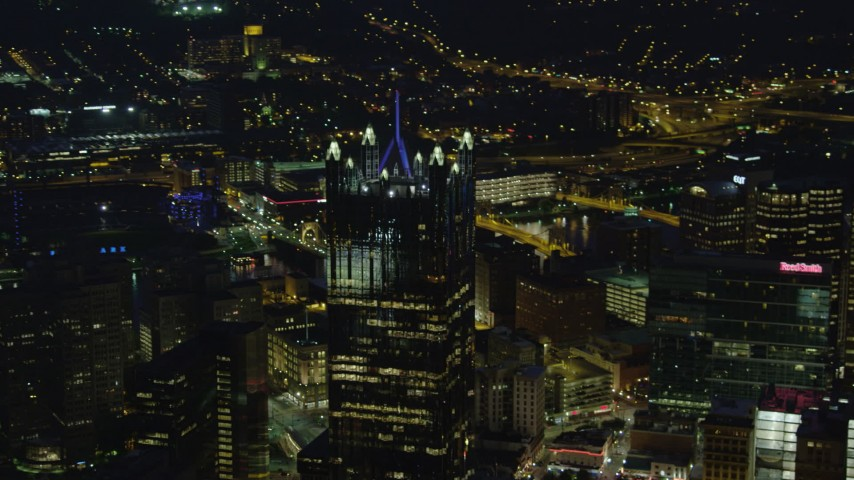 4K stock footage aerial video approaching PPG Place revealing Fifth Avenue Place, Downtown Pittsburgh, night Aerial Stock Footage | AX108_210