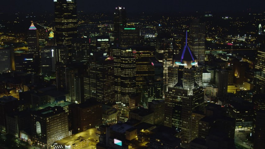 4K stock footage aerial video flying by skyscrapers, Downtown Pittsburgh, Pennsylvania, night Aerial Stock Footage | AX108_213