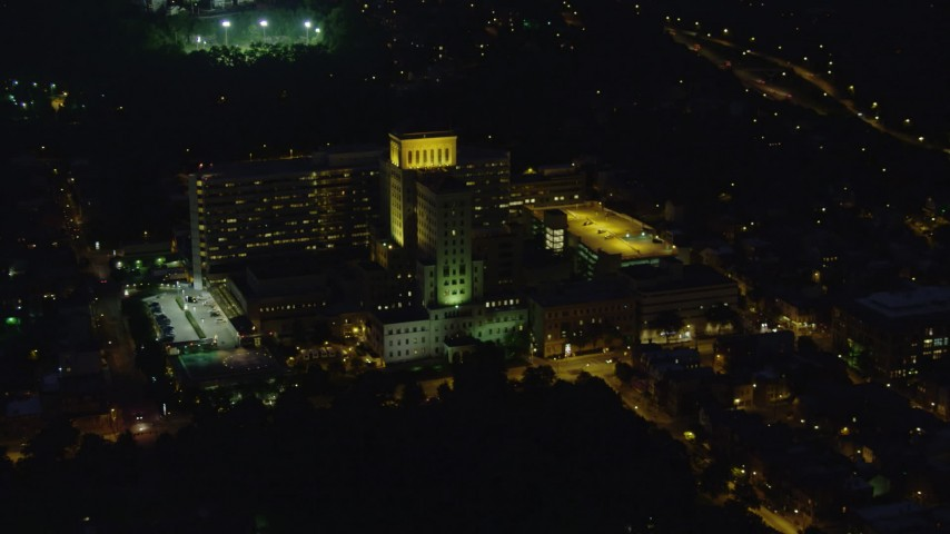 4K stock footage aerial video orbiting Allegheny General Hospital, Pittsburgh, night Aerial Stock Footage | AX108_214