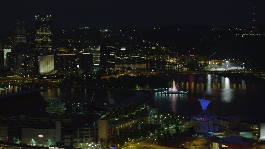 4K stock footage aerial video of Point State Park from Heinz Field, Downtown Pittsburgh, night Aerial Stock Footage | AX108_216