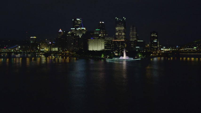 4K stock footage aerial video of a low approach toward Point State Park, Downtown Pittsburgh, night Aerial Stock Footage | AX108_218