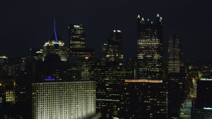 4K stock footage aerial video flying toward skyscrapers, Downtown Pittsburgh, Pennsylvania, night Aerial Stock Footage | AX108_220